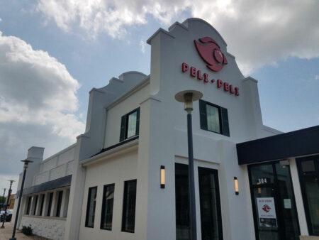red Houston channel letter sign Peli Peli restaurant with logo
