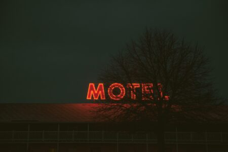 Tree blocking motel Houston outdoor signs