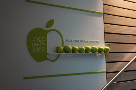 Creative Houston wall signs with apples to promote health